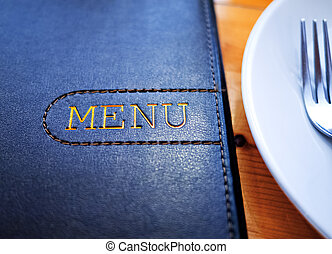 Menu - Black Leather Menu with White Plate on wood table.
