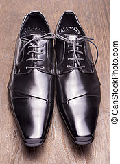 Black leather shoes - Front view of black leather shoes on a...