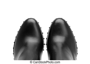 Black leather shoes on a white background