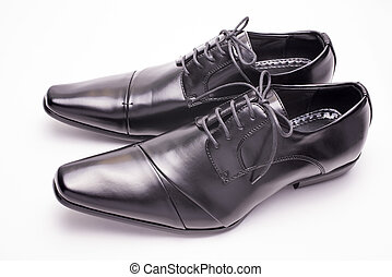 Black leather shoes - Sideways black leather shoes on a...