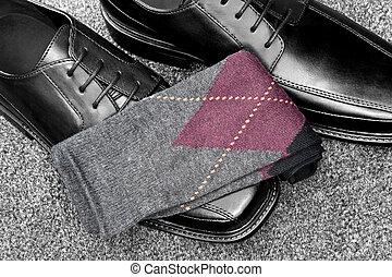 Black leather shoes with Argyle socks