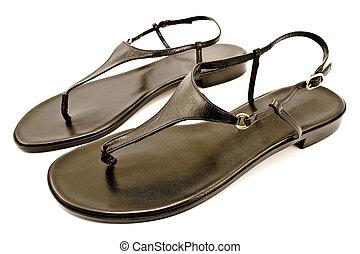 Black leather women's sandal shoe isolated on white
