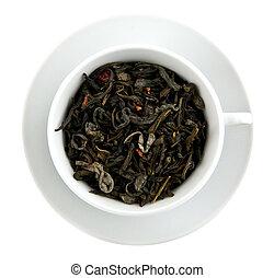 black leaves tea in teacup