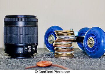 Black lens, small trolley and money