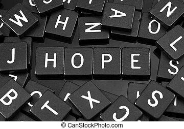 """Black letter tiles spelling the word """"hope"""""""