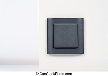 black light switch on the white wall