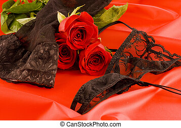 Black lingerie and red roses