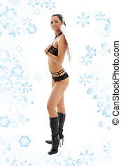 black lingerie angel in leather boots with snowflakes