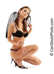 black lingerie angel on high heels over white