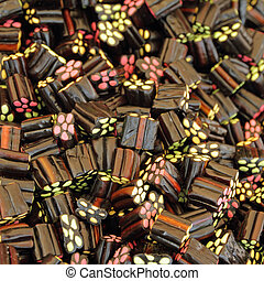 Black Liquorice Shooters candies as background