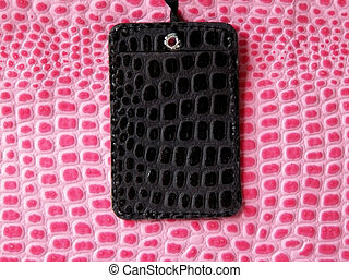 luggage tag - black luggage tag on a pink textured bag