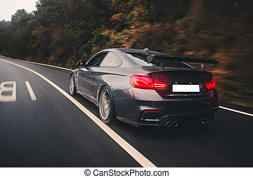 Black luxury sport coupe high speed drive