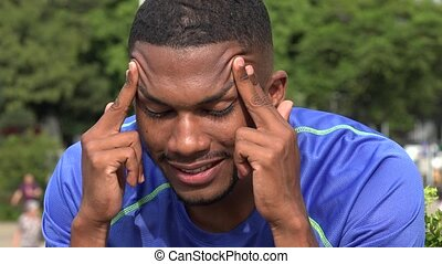 Black Male Athlete Massaging Temples