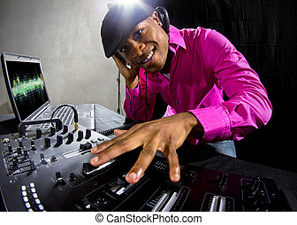 Black Male DJ - Cool African American male DJ playing music...