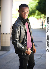 Black male fashion model posing in leather jacket