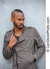 Black male fashion model posing outdoors