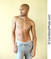 Black male fashion model posing shirtless