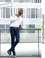 Black male fashion model smiling