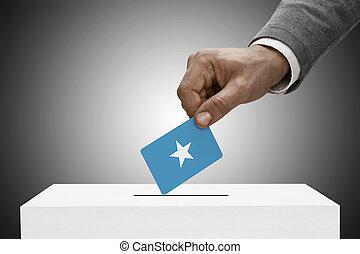 Black male holding flag. Voting concept - Federal Republic of Somalia