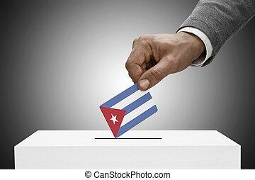 Black male holding flag. Voting concept - Cuba