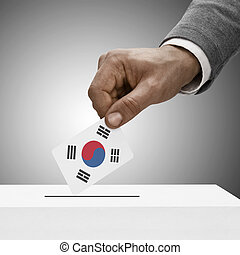 Black male holding flag. Voting concept - South Korea