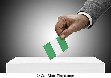 Black male holding flag. Voting concept - Nigeria