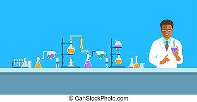 Black man chemist in chemical laboratory