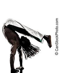 black man dancer dancing capoeira  silhouette