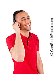 Black man having fun listening to music