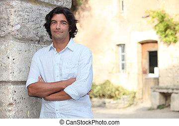 Black man in front of cottage