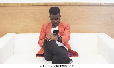 Black man in waiting room for job interview