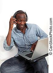 Black man listening to music on internet