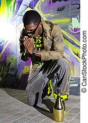 black man offers prayers