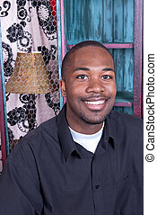 Black man smiling - A black man smiling while in his home ...