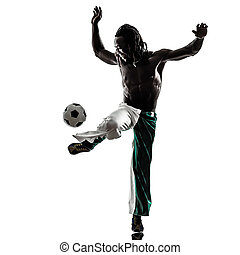 black man soccer player juggling football silhouette