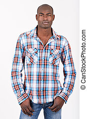 Black man wearing casual clothes in black background - ...
