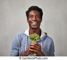 Black man with broccoli
