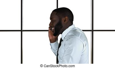 Black man with phone isolated.