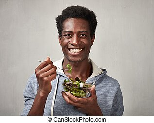 Black man with salad
