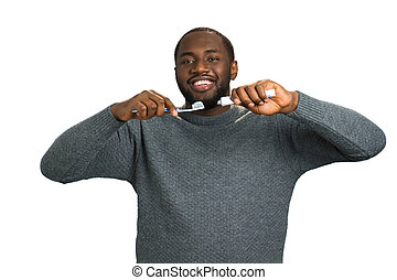 Black man with toothpaste and brush.