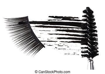 Black mascara stroke, brush and false eyelashes abstract composition, on white