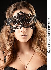black mask - Beautiful young woman with long wavy hair ...