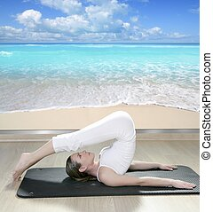black mat yoga woman window view of tropical beach