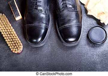 black men's shoes with care accessories