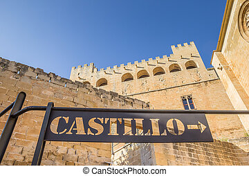 Black metal sign pointing to the castle of Valderrobres