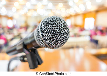 Black microphone in conference room .