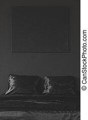 Black minimal monochromatic bedroom interior