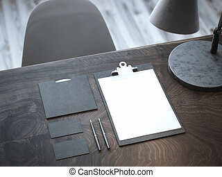 Black mockup on the wooden table. 3d rendering