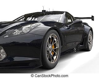 Black modern sports car - headlight closeup shot