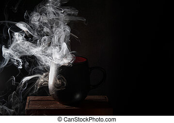 Black mug and dense steam lit from the side.